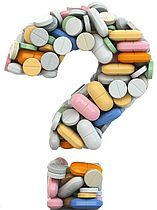 Pills as question on white isolated background. Medical concept.